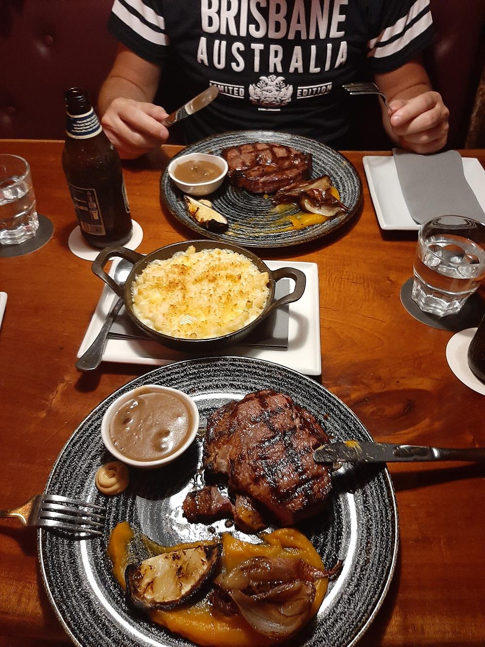 Enjoying a delicious tender steak at Iron Bar